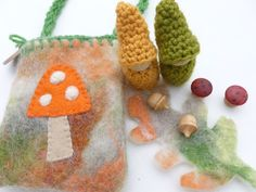 Two peg gnomes in a felted wool pouch. $15,00, via Etsy.
