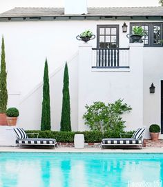 Pool + black and white loungers