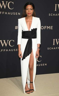 Naomie Harris cuts a fine figure at an IWC Schaffhausen gala dinner in Switzerland in a plunging Alexandre Vauthier couture gown cinched at the waist with a dramatic black belt. She also flaunts plenty of leg with a thigh-high slit.