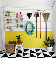This mudroom couldn't be more fun! From the bright yellow panel on the wall, to the graphic floor print, this work spot was transformed into one of the most fun rooms in the house.