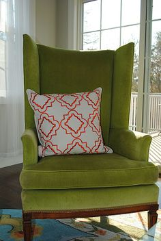 Green velvet wing chair with white/coral pillow. Time to reupholster our old chair for the bedroom!