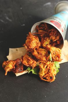 Onion Pakoras with Tamarind Chutney >>HAVE MADE. Crispy, tasty and very satisfying! (We used store-bought chutney but will try that part of the recipe if we ever need to. Indian Snacks, Indian Food Recipes, Asian Recipes, Vegetarian Recipes, Snack Recipes, Cooking Recipes, Healthy Recipes, Ethnic Recipes, Veggie Snacks