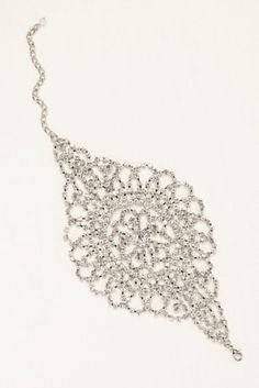 Inspired by an intricate lace design, this draping crystal bracelet is the perfect arm candyand accessoryto your bouquet!  Bracelet has a draping silhouette and covered in crystals.  Available in Silver.  Imported.