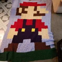 8 bit mario granny square blanket I made for my husband and few yrs back. First real project : crochet