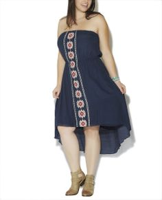 """Fun and fresh boho chic inspired tube dress features a gauze woven  body, tribal design embroidered along the front, cinch  waist with high low hem. Dress is fully lined.  Model is 5'9"""" and wears a size 1X.        58% Rayon / 42% Polyester - Lining: 100% Polyester      Machine Wash      Imported"""