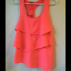 Neon hot pink tank top Neon ruffle tank top. Size small. Never been worn. Charlotte Russe Tops Tank Tops