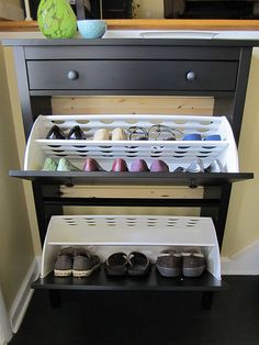 Hemnes shoe cabinet in small split foyer entry.      Love this Idea!  For storage as well as shoes.
