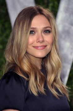 If you are in the process of growing out your hair, beachy waves like Elizabeth Olsen'sare the best way to give your hair a polished, styled look when the ends may not be too healthy.