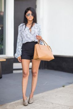 25 Spring Outfit Ideas with High Waisted Shorts - pastel patterned blouse + subtly textured, black high waisted shorts and taupe leather mules