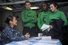 PACIFIC OCEAN (June 25, 2014) Sailors on board the aircraft carrier USS Nimitz (CVN 68) learn about educational opportunities at a career fair on the mess decks. Nimitz is currently underway performing routine operations and training exercises. (U.S. Navy photo by Mass Communication Specialist 3rd Class Aiyana S. Paschal/Released)