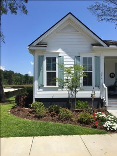 Can you say curb appeal for this cottage?  Our exterior shutters are the perfect accent for your home.  #exteriorshutters #curbappeal #homeimprovement #cottageliving