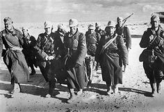 2.WW, North africa, war theater (Africa campaign) german Africa corps Feb.41-May43:German infantry marching in the libyen desert near El Agheila, Jan. 1942 - pin by Paolo Marzioli