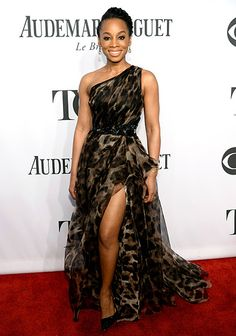Anika Noni Rose wears a leopard print one-shouldered gown by Badgley Mischka to the 2014 Tony Awards