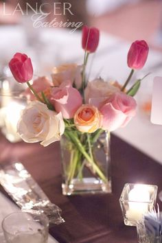 Tulips and roses are the perfect spring wedding flower.     Photo Credit to Camelot Photos