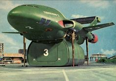Thunderbird 2 - A heavy-duty transporter aircraft designed to carry specialized rescue vehicles and equipment to disaster sites in one of six interchangeable pods. Featured in the British sci-fi supermarionation television series, Thunderbirds. Science Fiction, Joe 90, Thunderbirds Are Go, Classic Sci Fi, Classic Films, 3d Models, Scale Models, Animation, Film Serie