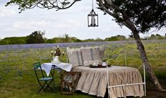 Tucked under a tree next to a field of native Bluebonnets, this outdoor bedroom on the 30-acre Cedar Hill Farms in Round Top, Texas, feels like an al fresco B&B. Its French country style makes it a graceful spot for owner and designer Anita Joyce to relax far away from the hustle and bustle of city life.