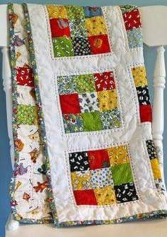Love the heavy handstitched quilting just outside the ninepatches. It makes this quilt stand out as special.