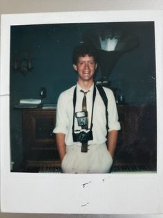 """Russ Murray with a Minolta camera and flash. I was playing the role of photographer (and later the DJ) at a """"party"""" which was actually a murder-mystery-theater night! Vintage Polaroid Camera, 35mm Camera, Polaroid Film, Polaroid Original, Mystery Theater, Fuji Instax, Instant Camera, The Dj, Great Photographers"""