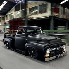 The Expendables movie truck, Ford F100 in flat black with a mild chopped top, black wheels, and what looks like DeSoto grille teeth.