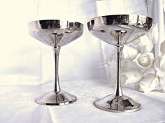 Check out this item in my Etsy shop https://www.etsy.com/ca/listing/496852655/silver-plated-champagne-glasses-silver