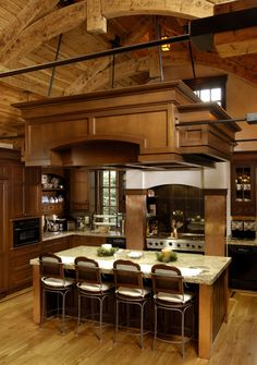 Kitchen - Terrific kitchen detail.in natural wood & stone. Just look at that ceiling design.