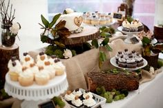 Cake love: a woodland wedding cake buffet with tree trunk cake stands | The Natural Wedding Company