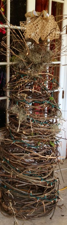 "Pulled grapevine ""bendy wood"" as my BFF calls it, from my woods. Wrapped around tomato cage turned upside down and voila! Going to use it year round. #Holidaydecorating"