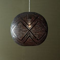 Perforated Globe Pendant - Diamond  from West Elm... 16: diameter. $109 on sale.  Three of these might look great in the entry way!