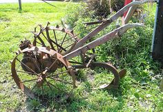 Learn how to use old farm equipment as decorative landscaping items