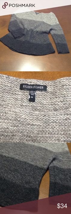Eileen Fisher Sweater Color block knit sweater. Fading from a creamy grey to a black and made from Italian yard. The frame naturally holds a beautiful bell shape and is so soft! In like New condition. 24' long from shoulder to hem and 17' at bust from pit to pit, lying flat. Plenty of stretch. Eileen Fisher Sweaters Crew & Scoop Necks