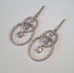 Vintage Sterling Silver Pave Double Hoop Chandelier Dangle Estate Earrings Statement Earrings Long Dangle Earrings by WOWTHATSBEAUTIFUL on Etsy https://www.etsy.com/listing/159173701/vintage-sterling-silver-pave-double-hoop