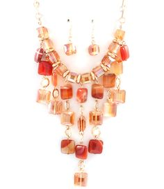 Idea, I can already see how I would make something with similar shaped stones: Necklace in Agate and Crystal