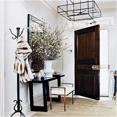 cover up some mirrors with large floral arrangements