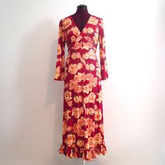 """70's Maxi Dress High Slit Long Empire Waist S M 70s raspberry red, gold, yellow, brown rose print, plastic diamond like jewels placed sporadically about by fabric glue.  It has an empire waist and a criss-cross bust has ties that go around and tie in the back creating a small keyhole at the top of the waist right under the bust and a high slit up one side that was created by somebody taking the seam out. Maker: Elaine Sklar (tag says lingerie Co  Bust- 36"""" to 38"""" Arm Length- 21"""" Waist- 31""""…"""