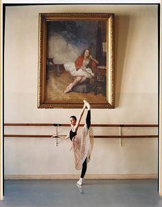 Painted portrait of famed Russian Ballerina Marina Semenova hangs behind student Ekaterina Bondarenko at the legendary Vaganova Ballet Adacemy in St. Petersburg, Russia, in 2006.