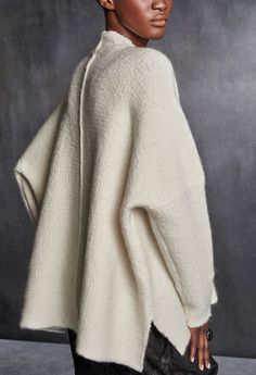 Oversized high-neck tweed sweater. Additional Information 34% CASHMERE 44% WOOL 22% POLYAMIDE Made of Italian Yarns Made in Italy Care Professional dry clean on
