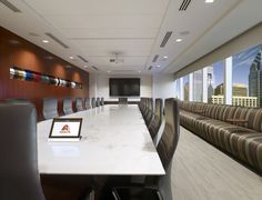 Main Boardroom with overflow banquette seating and a custom art installation