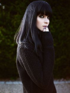 Black hair looks great with a heavy fringe