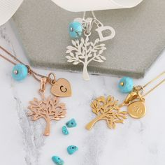 Personalised tree of life December birthstone necklace in silver, rose gold or gold. Full of symbolism the tree charm is a meaningful gift for a special occasion. Add additional charms to create a family tree Birthstone Charms, Birthstone Necklace, Turquoise Jewellery, December Birthday, Tree Of Life Necklace, Heart Locket, Pearl Stud Earrings, Initial Charm, Personalized Jewelry