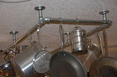 My husband made me a pot rack for Christmas out of galvanized pipe. I've posted it on my blog and there is a list of materials to make this yourself.