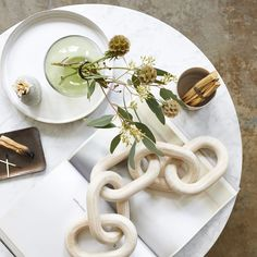 Our small link, Pale Wood chains are carved from salvaged wood by local artisans in the Honduras. Bring in natural elements to your home and shop today! Ikebana Arrangements, Whitewash Wood, Smudge Sticks, Spring Home Decor, Beach Stones, Salvaged Wood, Recycled Glass, Bud Vases, Earth Tones