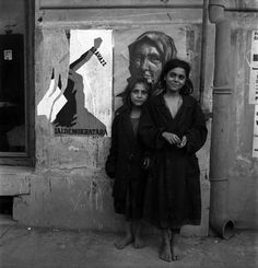 Homeless children in Budapest, Hungary, 1946. Miller's first assignment after the war. After the war Hungary and Romania were coming under communist control; the poster on the wall proclaims democracy and uses the image of a woman to do so. Miller was strongly critical of the part played by Germany's allies, but this was always tempered by compassion.