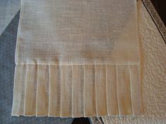Table Runner with Pleated Edge (have 3 of these) and 2 matching round tablecloths in taupe linen. Damask flocked linen fabric would compliment.