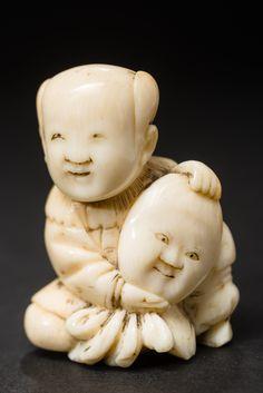 KARAKO BOY WITH MASK Netsuke, ivory Japan 19th cent. HEIGHT 3,9 CM