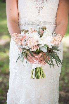 Peach stock, eucalyptus, white ranunculus,and scabiosa make this enchanting bouquet perfect for a garden wedding!