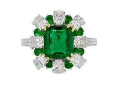 Emerald and diamond cluster ring, French, circa 1960.