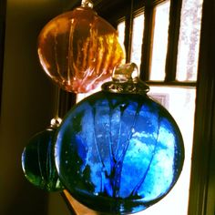 "Hand-Blown glass spheres - ""Witchballs"" - used to hang in front of windows and doors to capture any spells or unwanted attention from Witches... That's why there are strings of glass inside the glass ball."