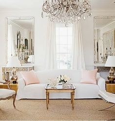 White interior with a hint of pink, elegant chandelier and mirrors.  LOVE THIS SPACE!!!