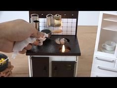 A Tiny Breakfast Cooked With Incredibly Small Foods Over a Fire in a Miniature Kitchen