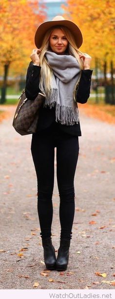 All black with a brown hat and bag